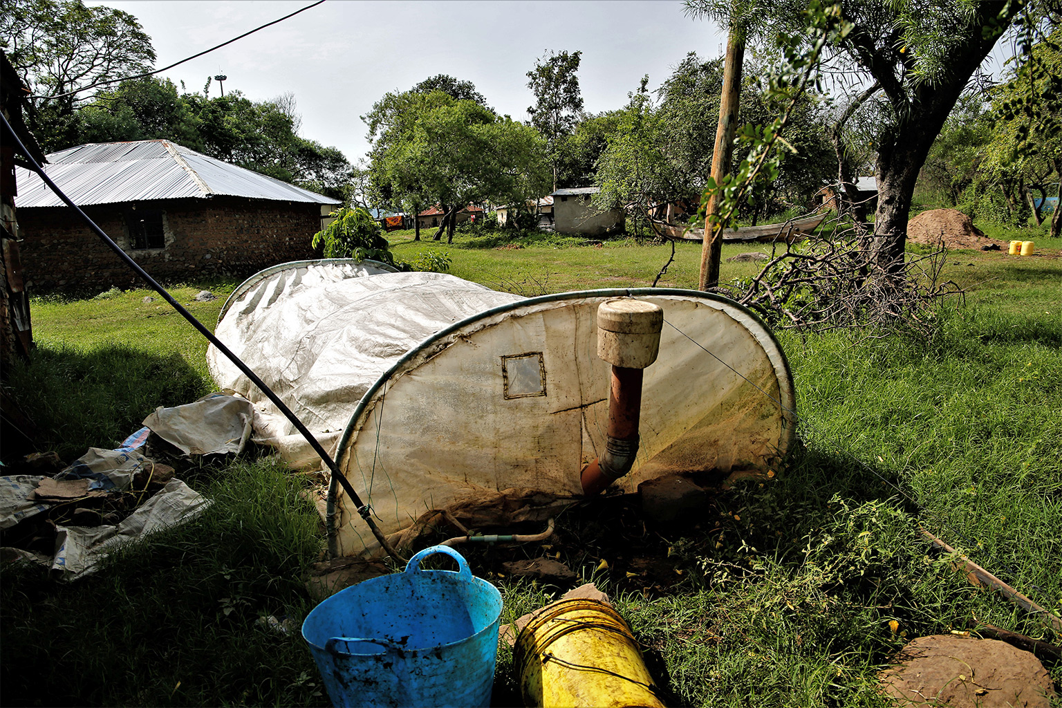 biogas digester unit installed a a Dunga village household. used for cooking. credit Anthony Langat