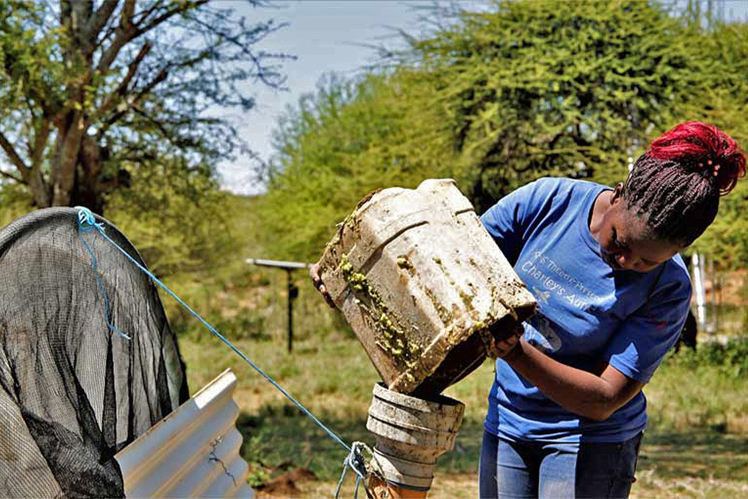 refilling biogas digester with prickly pear pulp. credit Anthony Langat.